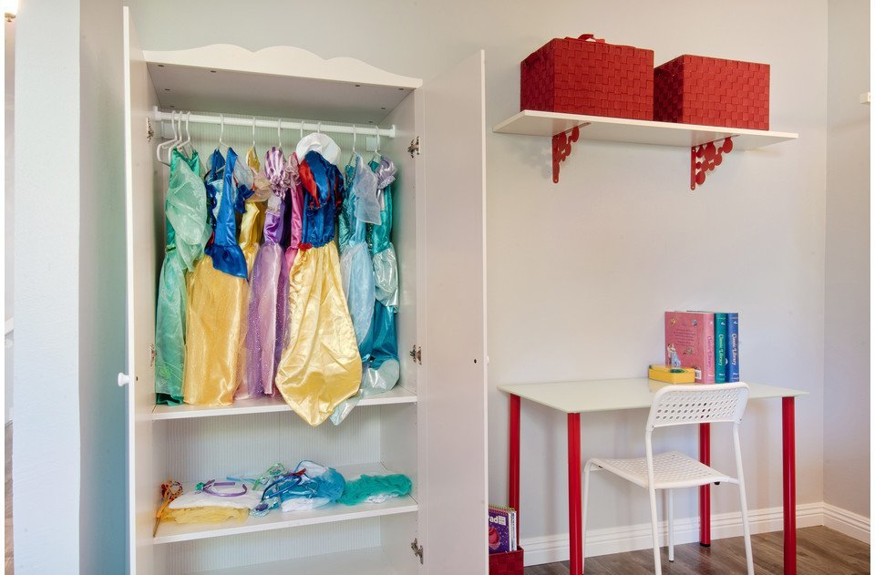 Kids will love the dress up clothes, desk, toys, books and coloring books.