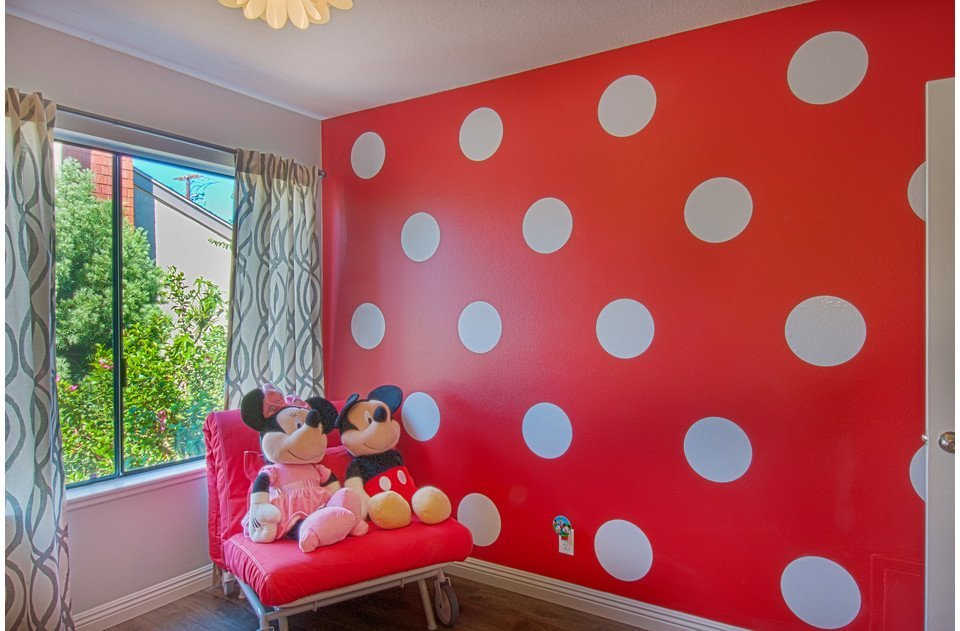 Super fun polka dots complete our Disney themed kids room.