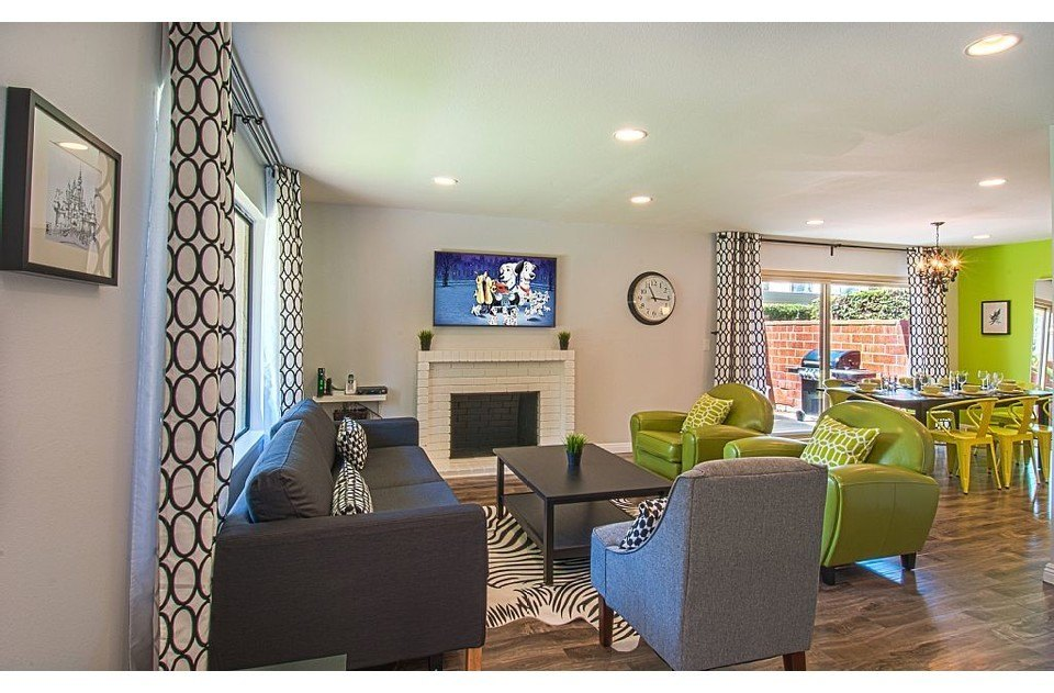 Lime green and black accents & Disney inspired club chairs welcome you home!