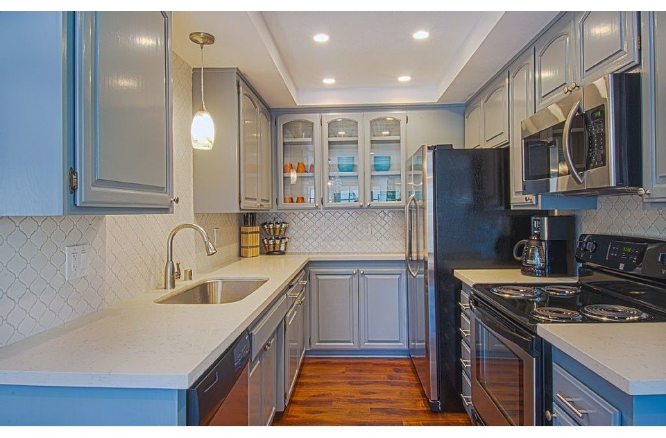 Custom Gray cabinets & lantern backsplash in our fully stocked kitchen!