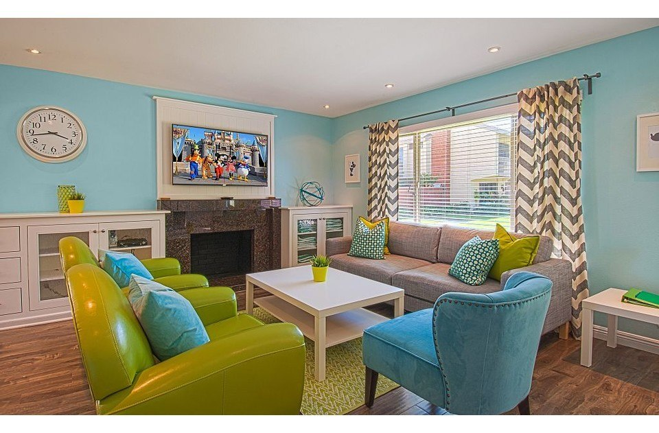 Fun colors in the livingroom are sure to lift any mood. Comfy seating helps too!