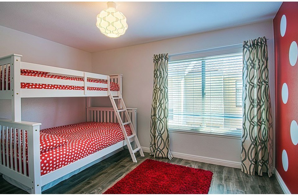 Minney themed kids room has a twin over double bunk, with a twin trundle.