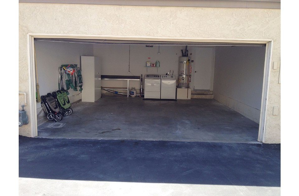 Attached 2 car garage is and laundry machines.