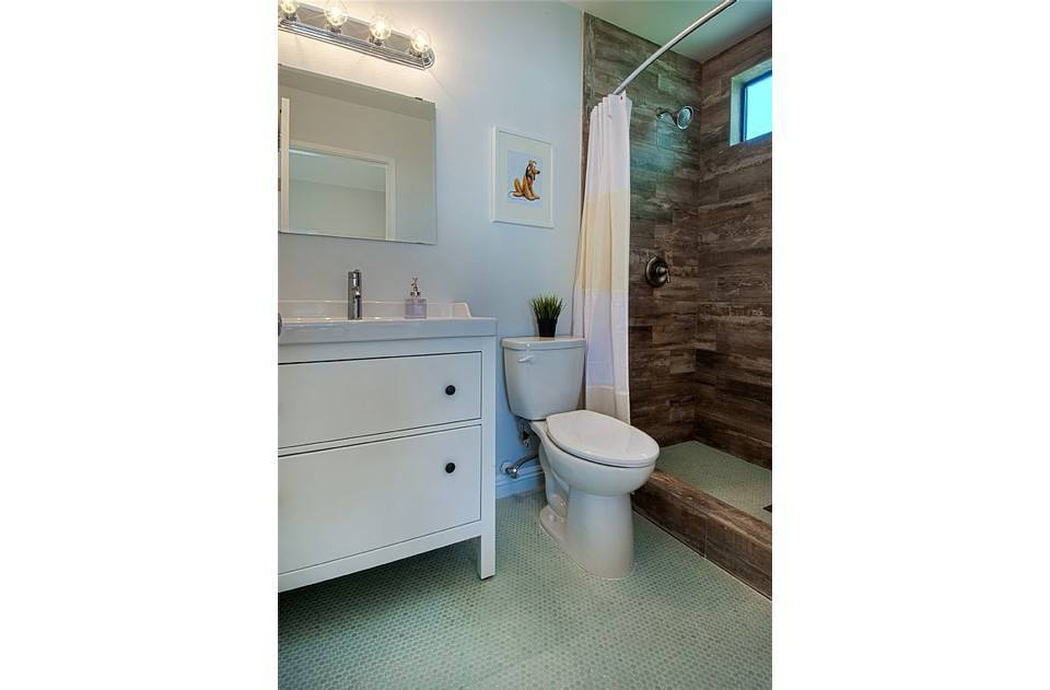 Master bath with custom shower.  Extra tall shower, unique wood tile walls!