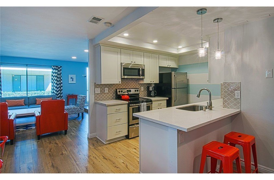 Modern kitchen with all new appliances. Custom backsplash. Chef's delight!