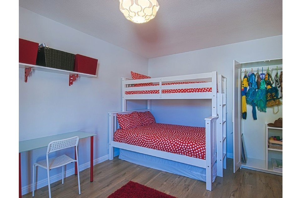 Kids room with twin over full bunk with twin trundle. Toys, games and dress ups!