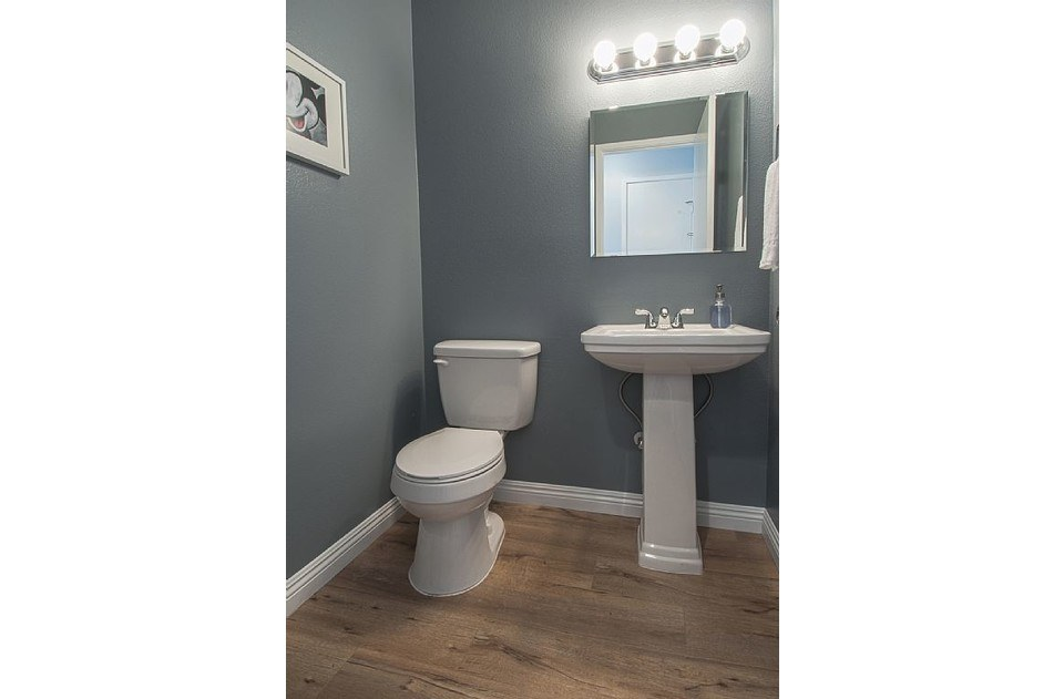 Half bath downstairs for your convenience. Cool colors and new fixtures!