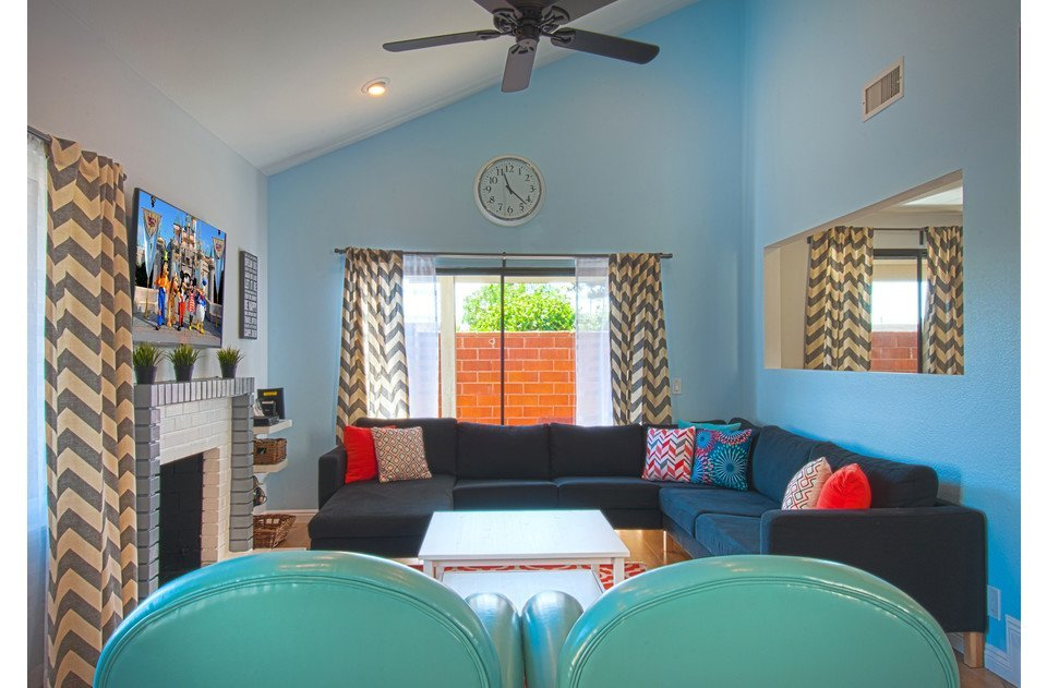 Fun, bright colors welcome you into our home. Lots of sofa seating to relax on!