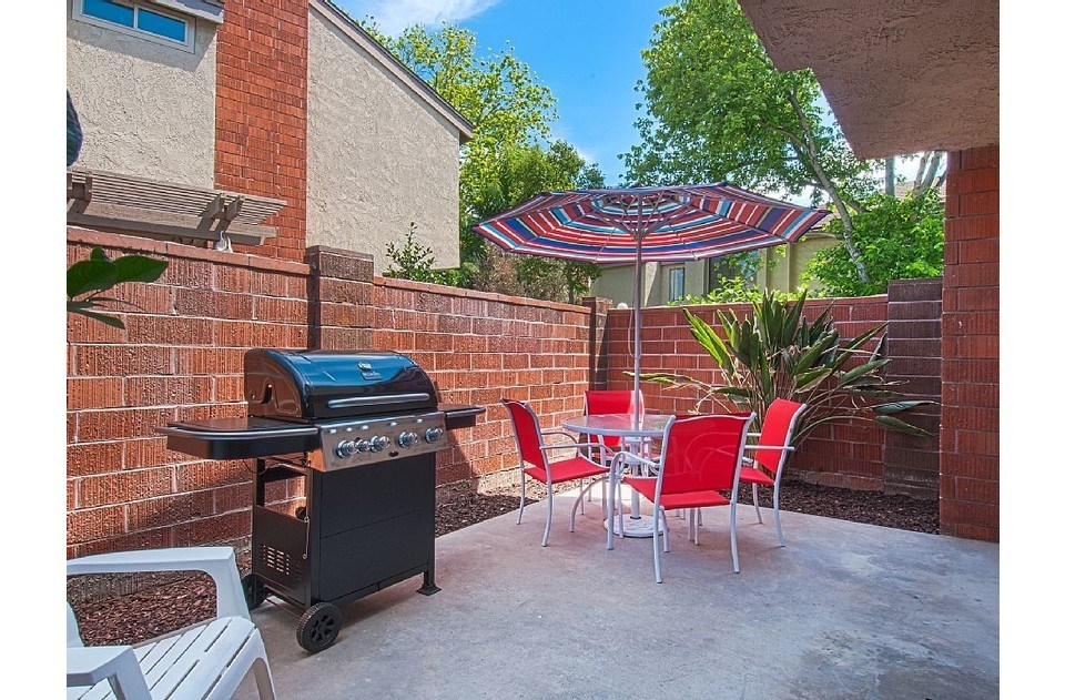 Patio with gas BBQ, table, chairs and umbrella to enjoy a beautiful SoCal day!