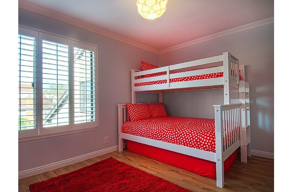 Twin over full bunk with twin trundle in this polka dot kids room. Kids love it!