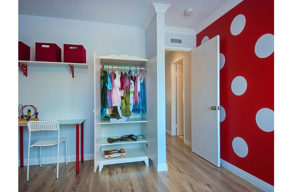 Kids love the polka dots, dress up clothes and toys in this room!