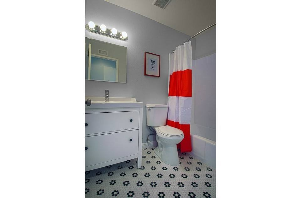 Full bath upstairs with fun tile and a remote shower head for easy kid's baths.