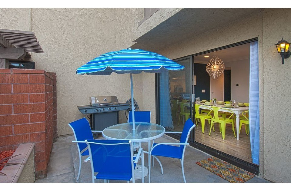 Side yard with patio set and a private propane grill! Enjoy our perfect weather.