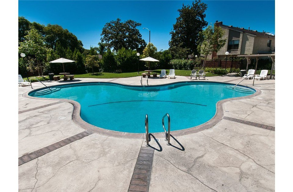 Take a dip in the Mickey shaped community pool! Tables and chairs for picnics!