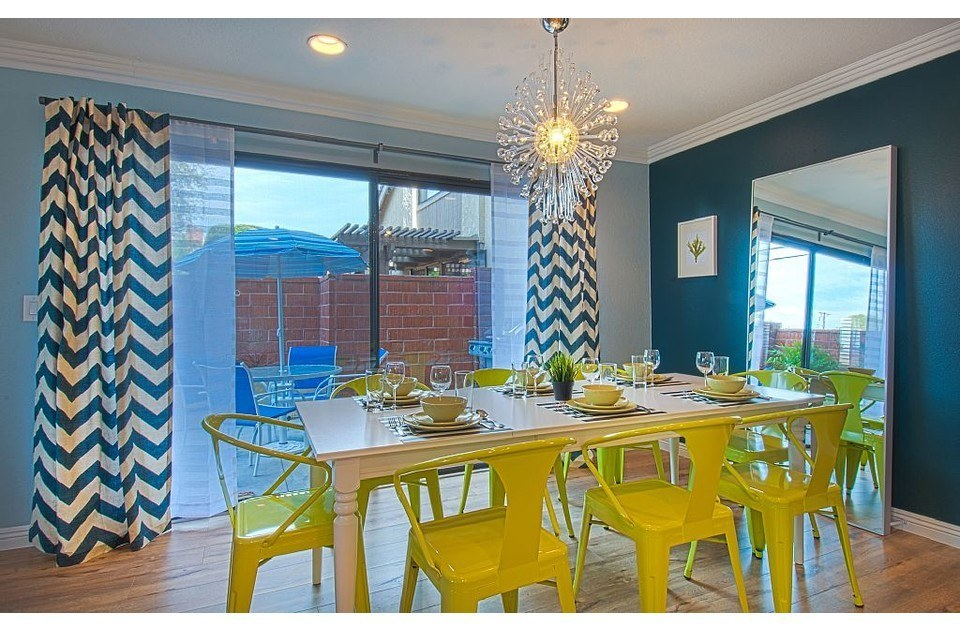 Fun colors in the dining area set the mood for family meals or game time.