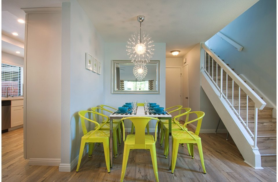 Vibrant lime chairs and fun chandelier create the perfect setting for dinner!