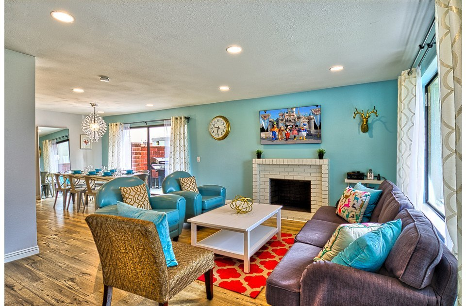 Comfy seating, fun colors, 55' flat screen, open layout. This living room rocks!