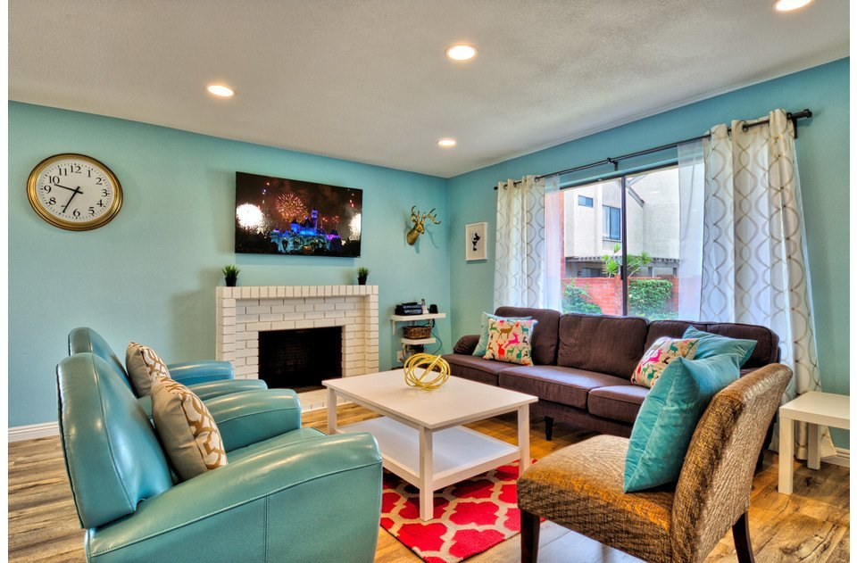 Fun and vibrant colors with gold accents and comfy seating!