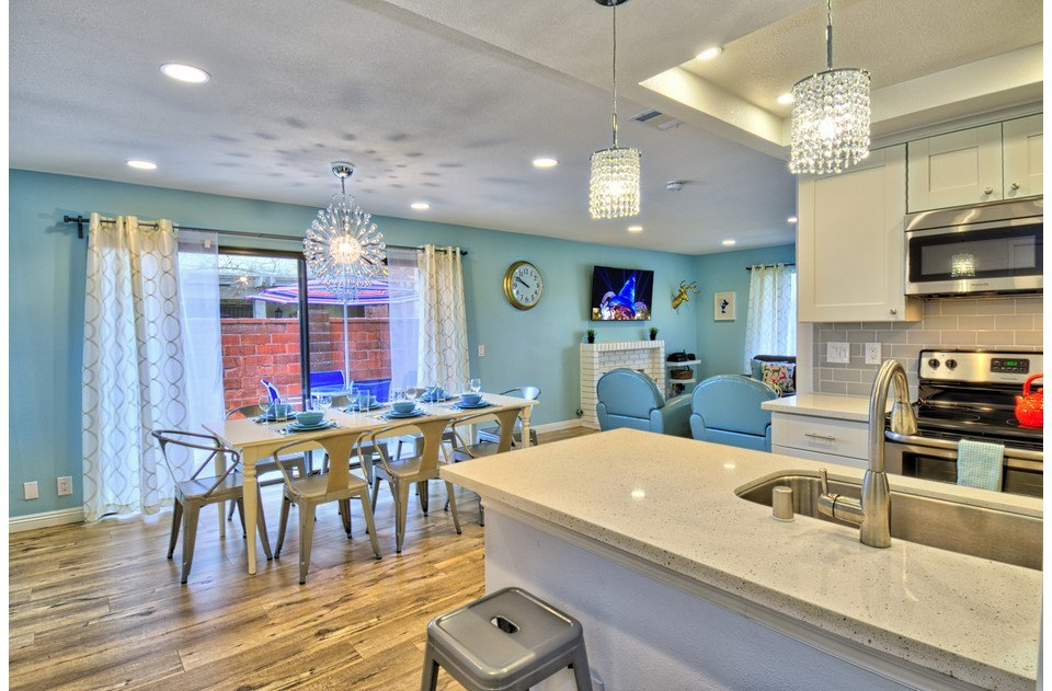 Open floor plan flows into dining and kitchen area. Fun colors throughout.